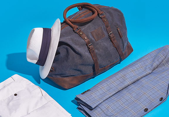 Men's travel bags | How to travel with tailoring guide